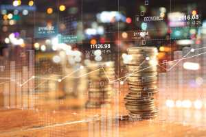 Double explosure with businesss charts of graph and rows of coins for finance at night city background.