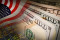 American flag and banknotes (USD) currency on Stock market