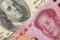 US dollar bill and China yuan banknote macro