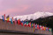 the congress center in Davos with flags of nations at sunrise du