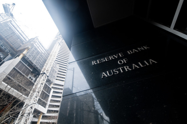 Reserve Bank of Australia name on black granite wall in Melbourne Australia with a reflection of high-rise buildings