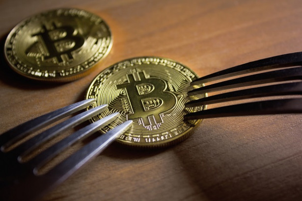 Two forks rest near bitcoin coin