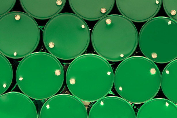 green steel chemical tanks or oil tanks stacked in row.
