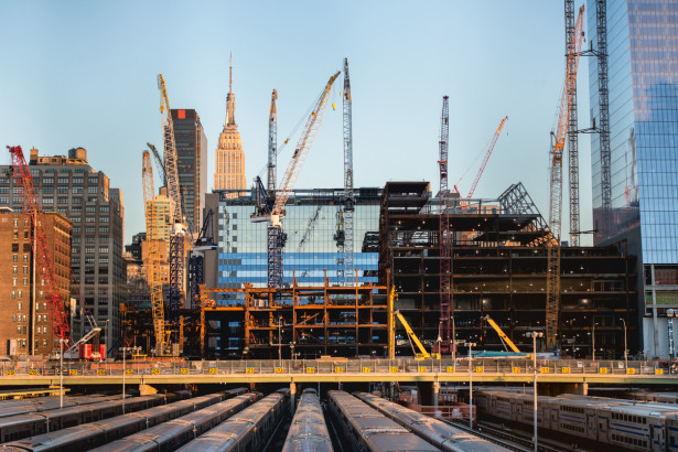 tall buildings under construction and cranes in New York City