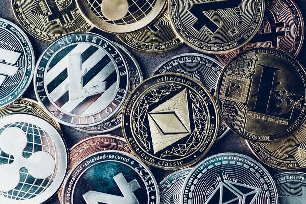Crypto currency background with various of shiny silver and golden physical cryptocurrencies symbol coins, Bitcoin, Ethereum, Litecoin, zcash, ripple