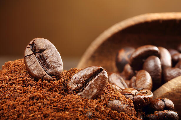 Coffee beans macro on a brown background