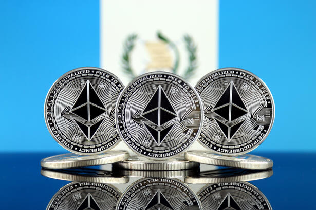 Physical version of Ethereum (ETH) and Guatemala Flag. Conceptual image for investors in cryptocurrency, Blockchain Technology, Smart Contracts, Personal Tokens and Initial Coin Offering.