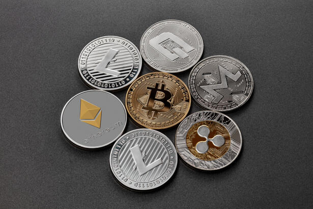 Coins of crypto currency are presented on a dark background. Virtual money concept.