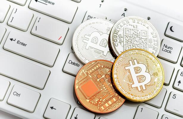 Bitcoin coin on white keyboard