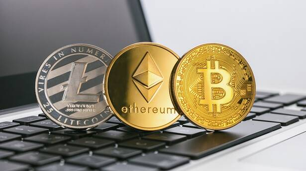 Aachen, Germany -September15, 2017: virtual Cryptocurrencys Ethereum, Bitcoin, Litecoin on a notebook, bitcoin Hype concept image. ideal for websites and magazines layouts
