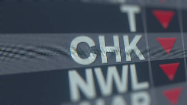 CHESAPEAKE ENERGY CHK stock ticker with decreasing arrow, conceptual Editorial crisis related 3D rendering