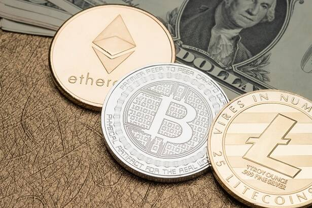 cryptocurrency Silver and gold Bitcoin,litecoin,ethereum on dollar banknote on golden table,Virtual Digital money on blockchain concept.financial business.crypto currency mining.