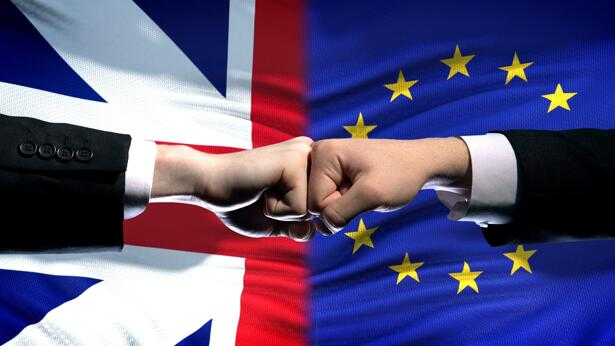 Great Britain vs EU conflict, international relations, fists on flag background