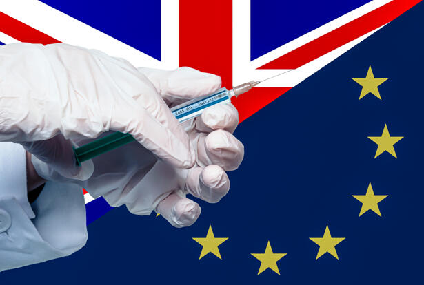 split flags of europe and uk with a covid 19 vaccine syringe in the foreground