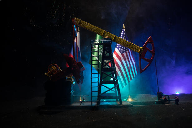Business dialogue, oil agreement concept: National flags with Oil pump and oil refining factory at night with fog and backlight. Energy industrial concept.