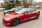 PARIS, FRANCE - NOVEMBER 29: Row of New Tesla Model S cars in front of showroom in Paris, France. Tesla is an American company that designs, manufactures, and sells electric cars