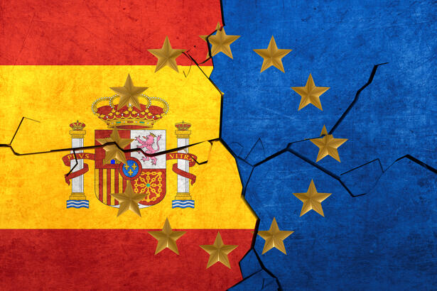 European union and Spainish flags breaking apart