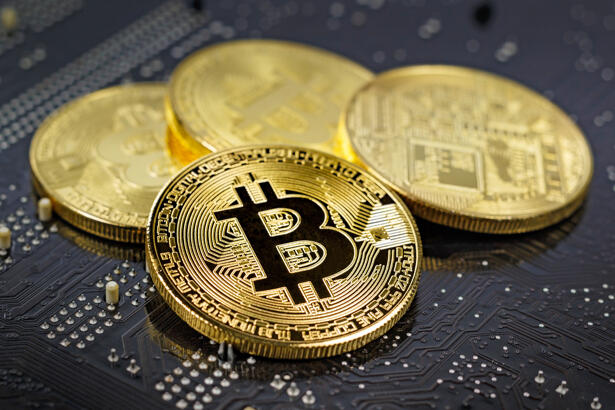 Golden bitcoins on the black background closeup. Cryptocurrency virtual money