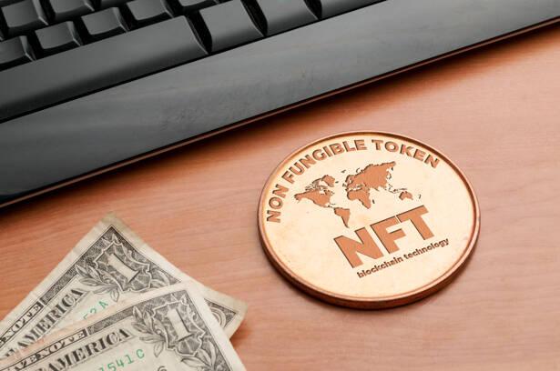 Nft (non fungible token) concept: big copper coin on a wooden ta