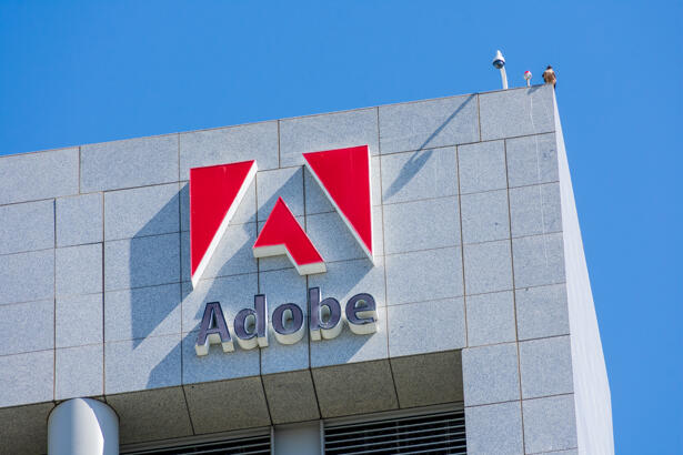 Adobe logo on Adobe Inc headquarters building in the downtown of Silicon Valley largest city - San Jose, CA, USA - 2020