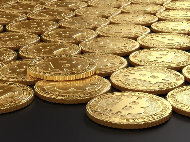 Group of golden Bitcoin coins arranged in a grid