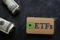 ETF (Exchange Traded Fund ) tag with cash and dark background