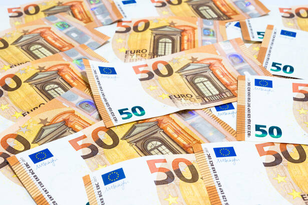 Pile of many fifty euro banknotes use for money or currency back
