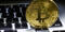 Golden bitcoin with credit card on top of dollar banknote backgr