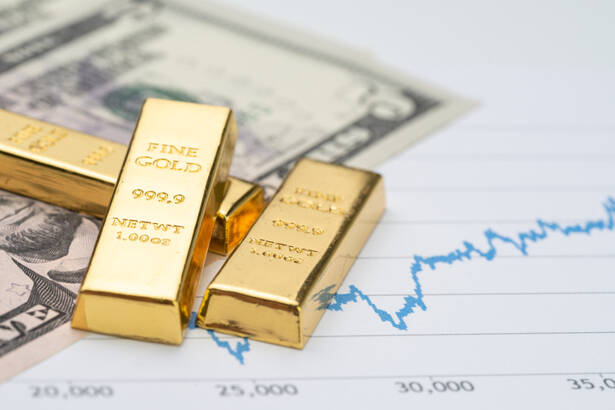 Gold bullion ingot stack on america US dollar banknote money and rising price graph as crisis safe haven, financial asset, investment and wealth concept