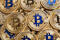 Many golden bitcoins, closeup