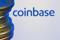 Coinbase logo and Bitcoins