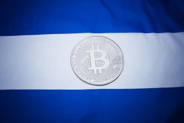 El Salvador flag with bitcoin. Bitcoin law concept.