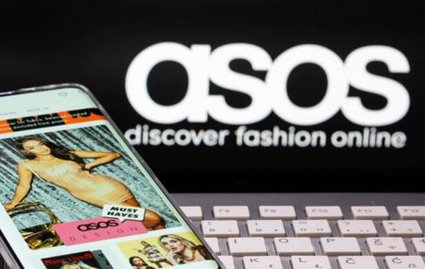 Smartphone with an ASOS app and a keyboard are seen