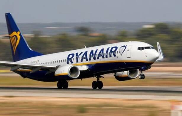 FILE PHOTO: A Ryanair Boeing 737 airplane takes