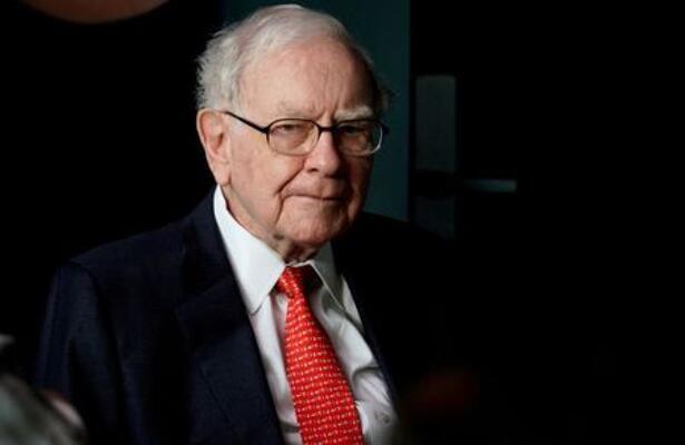 Warren Buffett, CEO of Berkshire Hathaway Inc, pauses