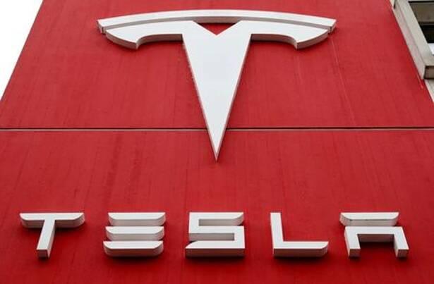 The logo of car manufacturer Tesla is seen