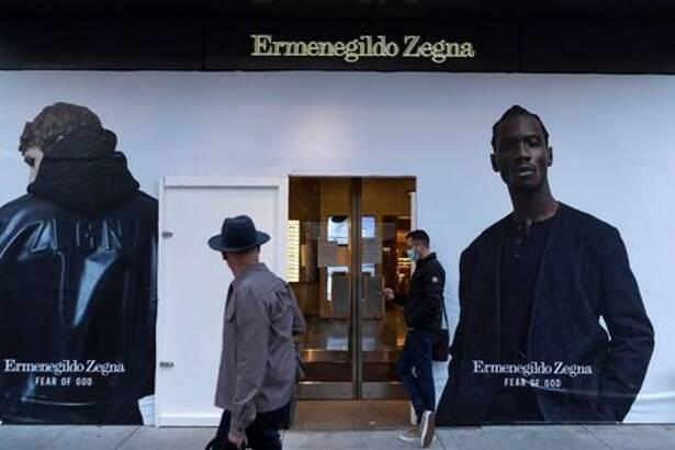 Plywood covers the window of Ermenegildo Zegna store in Chicago