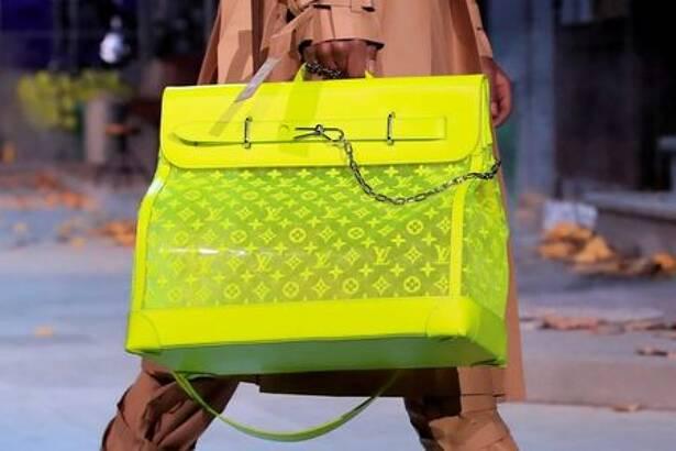 A model presents a bag creation