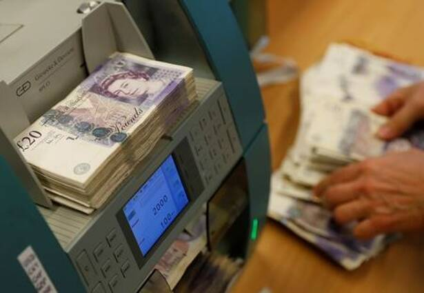 British Pound Sterling banknotes are seen in a counter machine at the Money Service Austria company's headquarters in Vienna