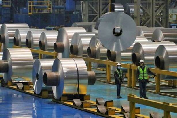 FILE PHOTO: Employees work at the production line of aluminium rolls at a factory in Zouping