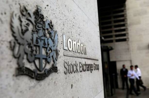 FILE PHOTO: Pedestrians leave and enter the London Stock Exchange in London