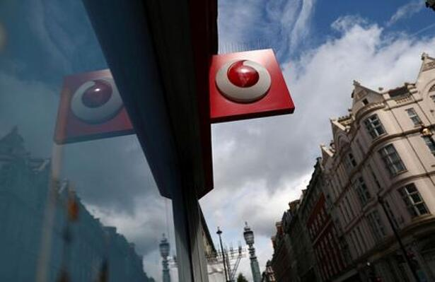 A branded sign is displayed on a Vodafone
