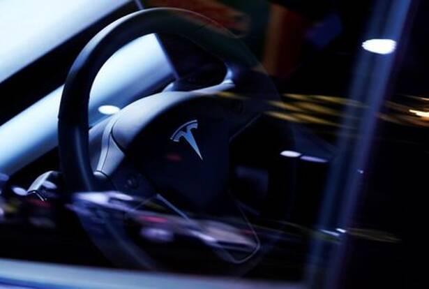 A Tesla Model S steering wheel is on display at