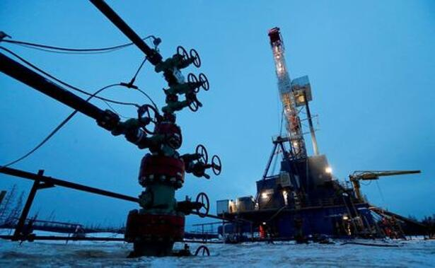 A well head and drilling rig in the