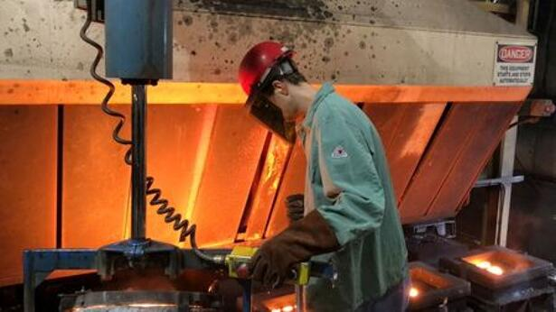 A worker pours hot metal at the Kirsh