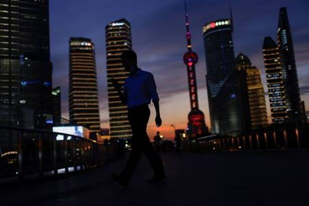 Lujiazui financial district during sunset in Pudong, Shanghai