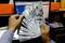 A trader shows U.S. dollar notes at a