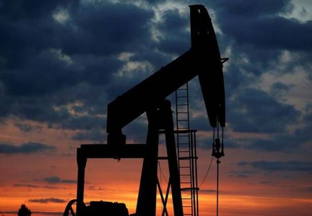 FILE PHOTO: An oil pump is seen at sunset outside