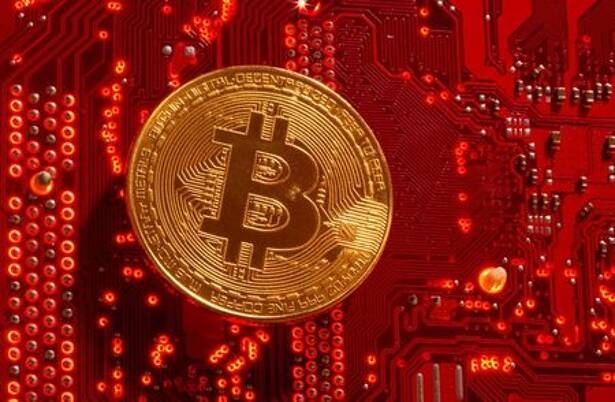 FILE PHOTO: Representation of cryptocurrency Bitcoin is placed on PC motherboard in this illustration taken