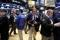 FILE PHOTO: FILE PHOTO: Traders work on the floor of the New York Stock Exchange (NYSE) shortly after the opening bell of trading session in New York